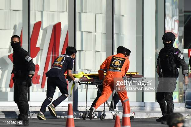 Medical personnel prepare to enter the Terminal 21 mall where a mass shooting took place and the gunman is currently still hiding to help injured...