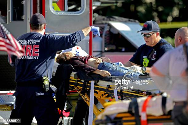 Medical personnel tend to a victim outside of Marjory Stoneman Douglas High School in Parkland Fla after a shooting on Wednesday Feb 14 2018
