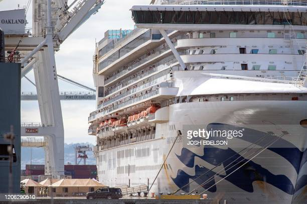 Medical personnel tend to passengers as they disembark from the Grand Princess cruise ship at the Port of Oakland in California on March 09 2020 The...