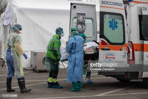 Medical personnel transport the first patient affected by COVID19 to an ICU tent a Samaritan's Purse Emergency Field Hospital on March 20 2020 in...