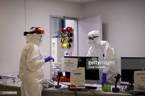 Medical personnel wear protective suits, masks, gloves and face shields during their shift inside the COVID 19 area at the Krakow University Hospital...
