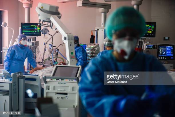 Medical personnel wear protective suits, masks, gloves and face shields during their shift at the ICU of Krakow University Hospital on September 04,...