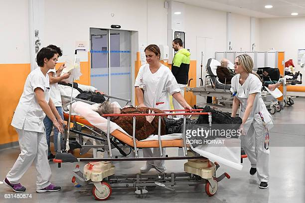 Medical personnel work in the emergency room of Hopital de la Timone hospital in Marseille on January 11 2017 French hospitals are being stretched to...