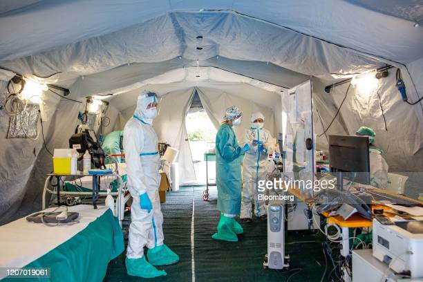 Medical personnel work inside a triage tent at a hospital in Brescia Italy on Friday March 13 2020 Europe's largest coronavirus outbreak is putting...