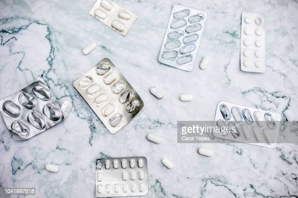 medical pills in grey  background - acetaminophen stock photos and pictures