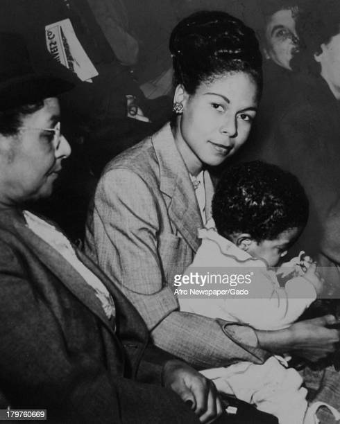 Medical practitioner Rachel Robinson, her mother in law, and her infant son are shown taking a 'break' during the seventh inning of a game featuring...