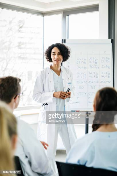 medical professional hosting seminar - responsibility stock pictures, royalty-free photos & images