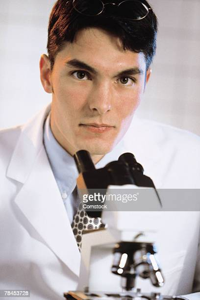 Medical professional in lab with microscope