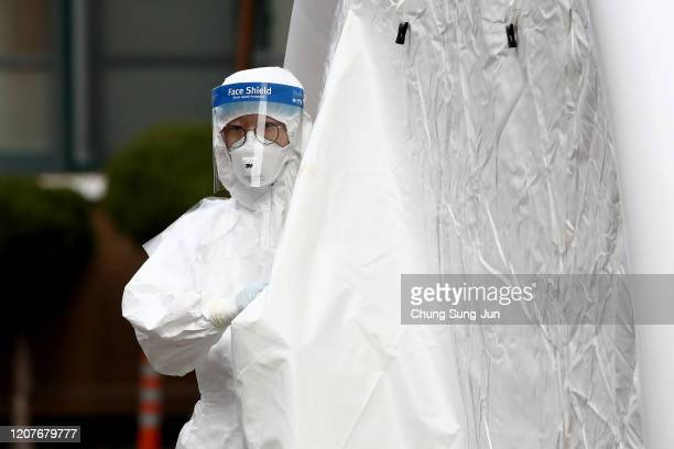 A medical professional is seen at a preliminary testing facility at the National Medical Center where patients suspected of contracting coronavirus...