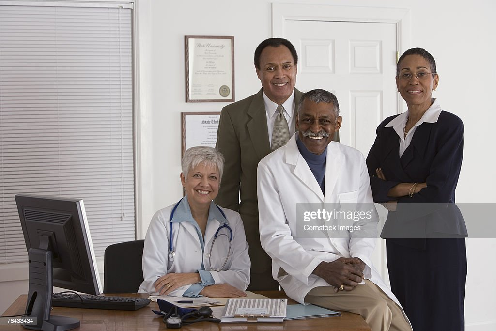 Medical professionals and businesspeople : Stockfoto