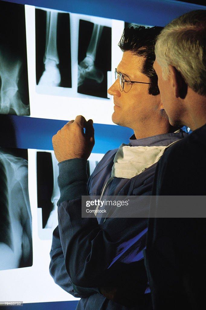 Medical professionals examining x-rays : Stock Photo