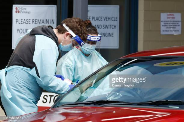 Medical professionals perform COVID testing at a drive through clinic in Ballarat on August 21, 2020 in Ballarat, Australia. COVID-19 testing in...