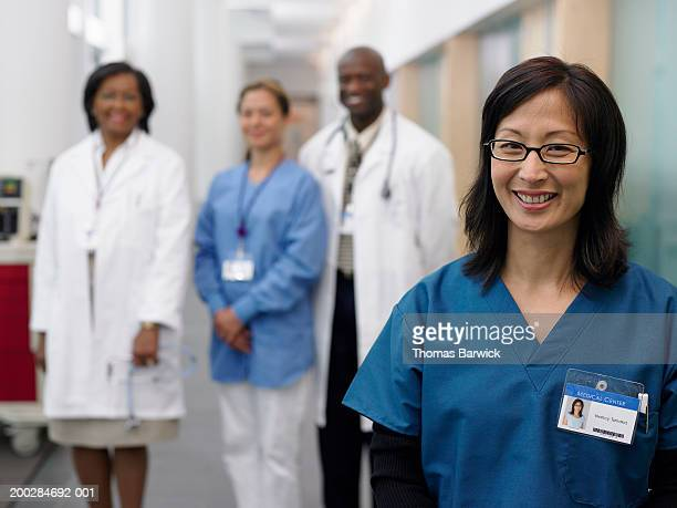 medical professionals, portrait (focus on mature woman in foreground) - id card stock pictures, royalty-free photos & images