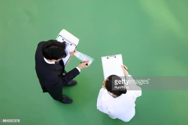 Medical salesman explaining to doctor about medicine