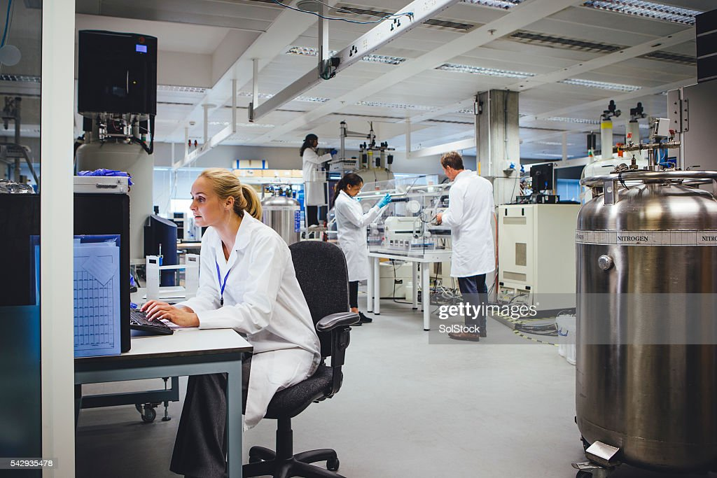 Medical Science Professionals Working in a Laboratory : Stock Photo