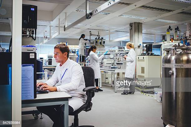 medical science professionals working in a laboratory - place of research stock pictures, royalty-free photos & images