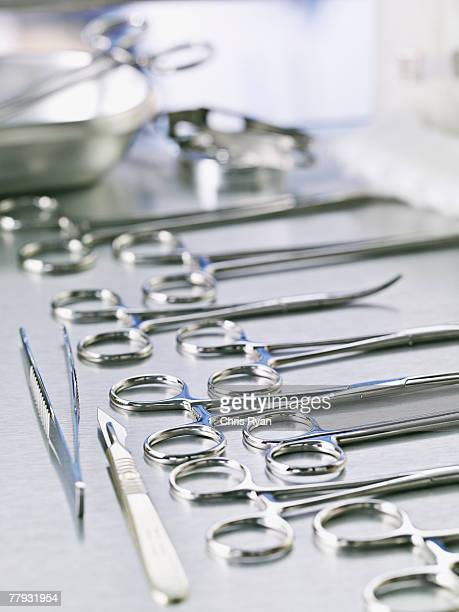 medical scissors and scalpel on table - surgical equipment stock photos and pictures