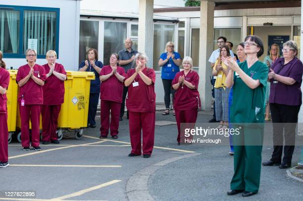 Medical staff and members of the public congregate outside Nevill Hospital and clap in support of the work and support of the NHS, Carers and Key...