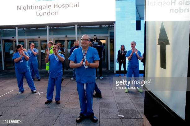 Medical staff and workers take part in a national clap for carers to show thanks for the work of Britain's NHS workers and other frontline medical...