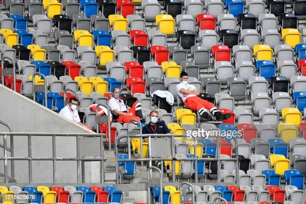 Medical staff are seen sitting in empty seats inside the stadium prior to the Bundesliga match between Fortuna Duesseldorf and FC Schalke 04 at...