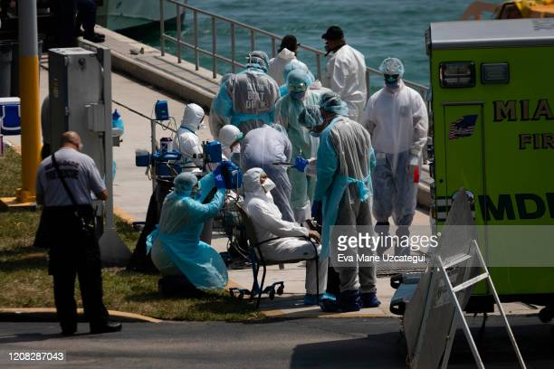 Medical staff attend suspected Coronovirus patients as they arrive at U.S. Coast Guard Base Miami Beach on March 26, 2020 in Miami, Florida....