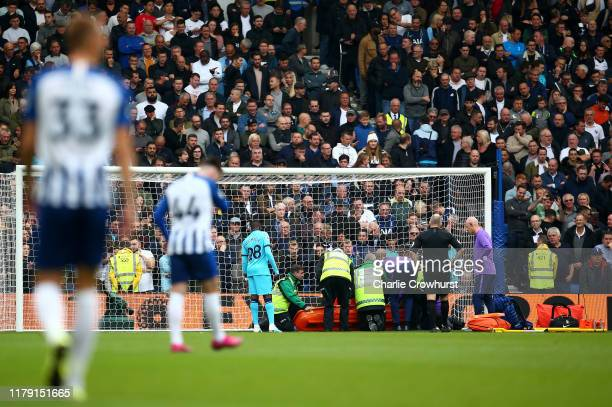 Medical staff attend to Hugo Lloris of Tottenham Hotspur after an injury leading to the opening goal for Brighton and Hove Albion during the Premier...