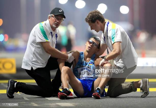 Medical staff attend to Maryan Zakalnytskyy of Ukraine in the Men's 50km Race Walk final during day two of 17th IAAF World Athletics Championships...