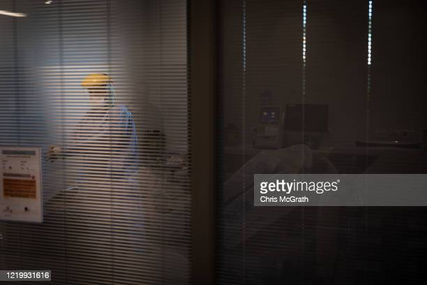 Medical staff check on a patient infected with the COVID19 virus in the COVID19 dedicated ICU at the Acibadem Altunizade Hospital on April 16 2020 in...