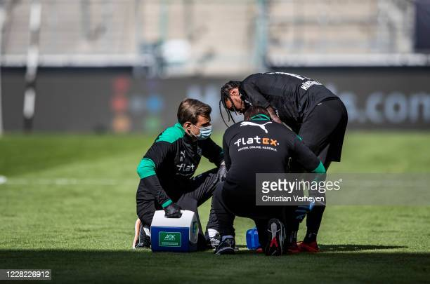 Medical Staff check the injured Valentino Lazaro of Borussia Moenchengladbach during the PreSeason friendly match between Borussia Moenchengladbach...