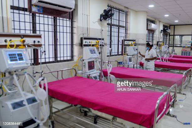 A medical staff checks on a ventilator of an intensive care unit at a newly inaugurated hospital by the Tamil Nadu state during a governmentimposed...