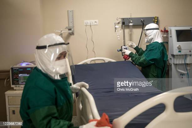 Medical staff clean and disinfect a bed after a COVID-19 patient was discharged from the the Kartal Dr. Lutii Kirdar Education and Research Hospital,...