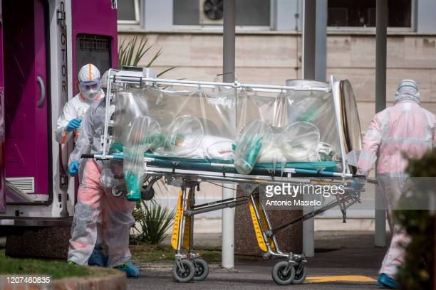 Medical staff collect a patient from an ambulance at the second Covid19 hospital in the Columbus unit on March 17 in Rome Italy Italian Government...