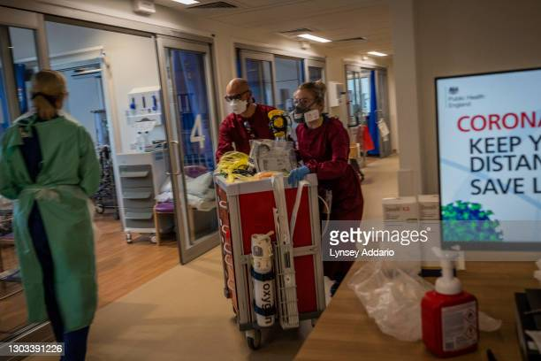 Medical staff distributing the oxygen bottles and equipment around Critical Unit at Royal Papworth Hospital on June 15, 2020 in Cambridge, United...