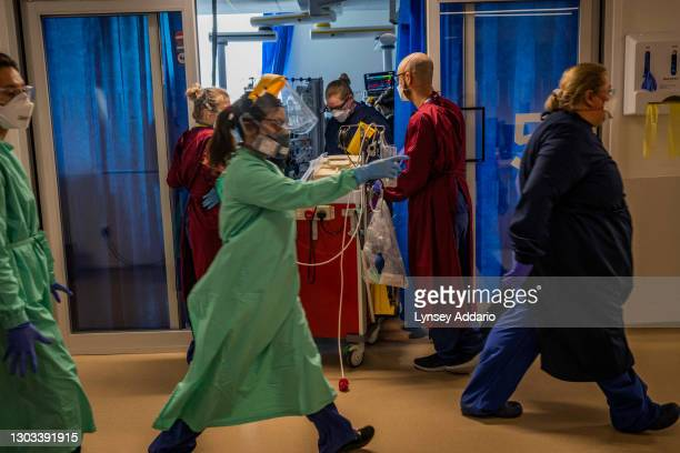 Medical staff distributing the oxygen bottles and medical equipment around Critical Unit at Royal Papworth Hospital on June 15, 2020 in Cambridge,...