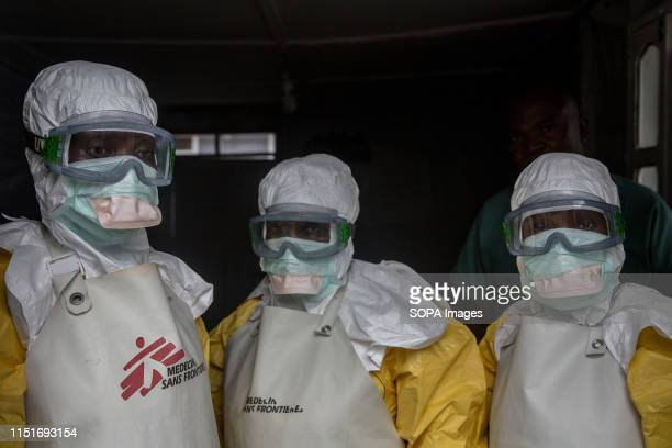 Medical staff dressed in protective gear before entering an isolation area at an Ebola treatment centre in Goma DR Congo is currently experiencing...