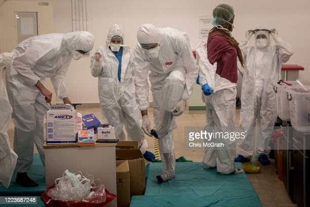 Medical staff get dressed in personal protective equipment before assisting COVID-19 patients in the Kartal Dr. Lutii Kirdar Education and Research...