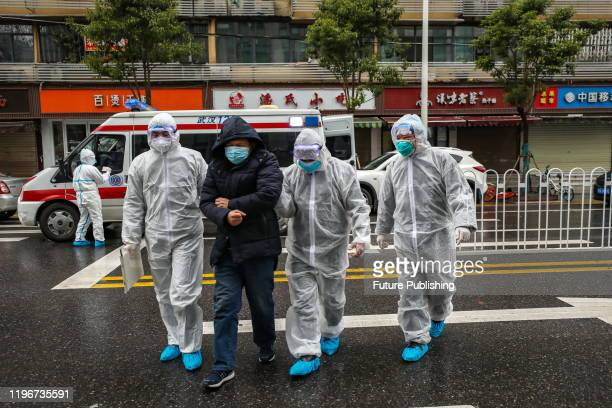 Medical staff help a patient walk into the hospital in Wuhan in central China's Hubei province Sunday Jan 26 2020 PHOTOGRAPH BY Feature China /...
