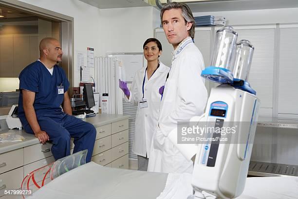 Medical Staff in Hospital Room