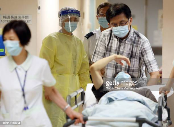 Medical staff in protective outfits as a precautions of potential Middle East respiratory syndrome coronavirus outbreak is seen at the Kwong Wah...