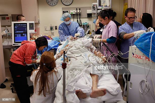 Medical staff in the Trauma Unit at the John H Stroger Jr Cook County Hospital try to save the life of a man who was hit by a car November 6 2009 in...