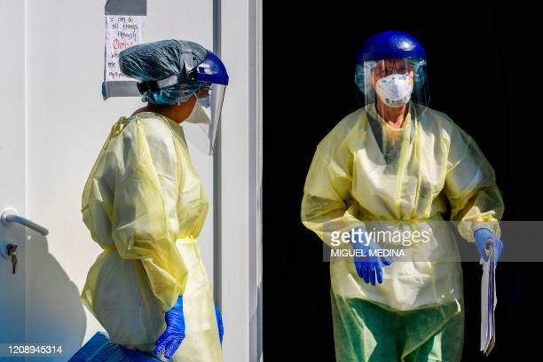 Medical staff is pictured on April 2 2020 while working at the operative field hospital for coronavirus patients financed by US evangelical Christian...