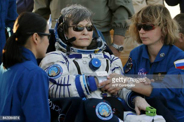 NASA medical staff members examine International Space Station crew member US astronaut Peggy Whitson shortly after she landed in a remote area...