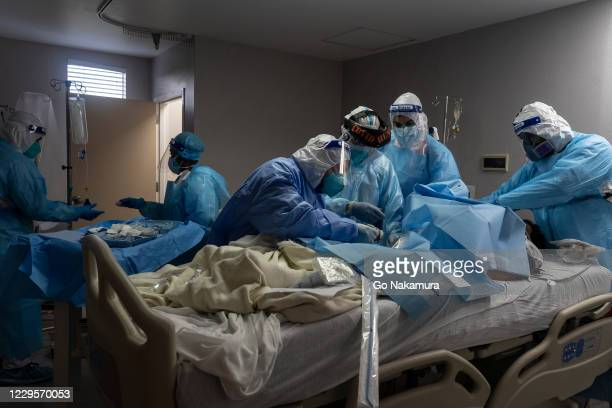 Medical staff members treat a patient suffering from coronavirus in the COVID-19 intensive care unit at the United Memorial Medical Center on...
