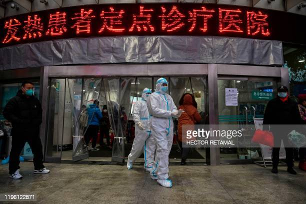 TOPSHOT Medical staff members wearing protective clothing to help stop the spread of a deadly virus which began in the city walk at the Wuhan Red...