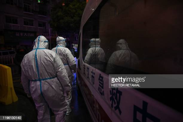 Medical staff members wearing protective clothing to help stop the spread of a deadly virus which began in the city walk at the Wuhan Red Cross...