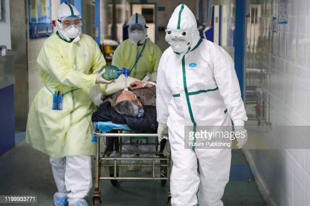 Medical staff move a 2019nCoV patient into the isolation ward in a hospital in Wuhan in central China's Hubei province Thursday Feb 06 2020...