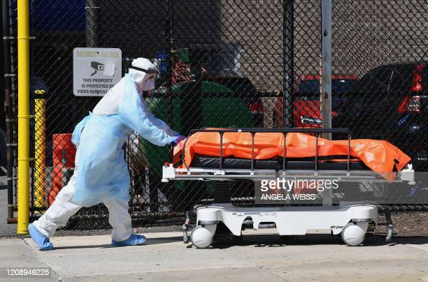 Medical staff move bodies from the Wyckoff Heights Medical Center to a refrigerated truck on April 2 2020 in Brooklyn New York The Federal Emergency...