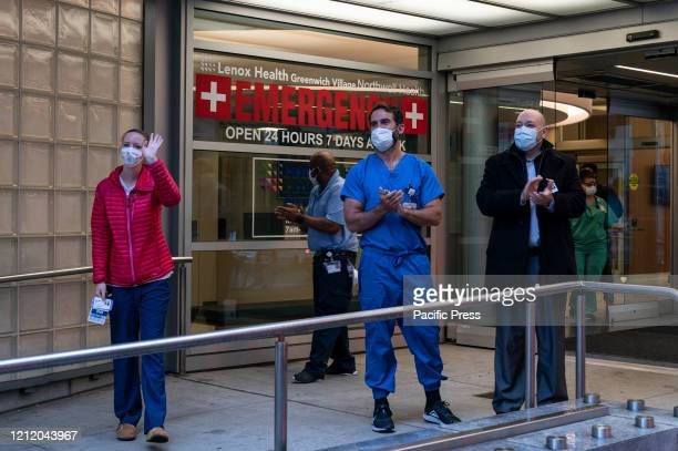 Medical staff of Lenox Hill Greenwich Village hospital part of Northwell Health come outside while people show gratitude for their care of patients...
