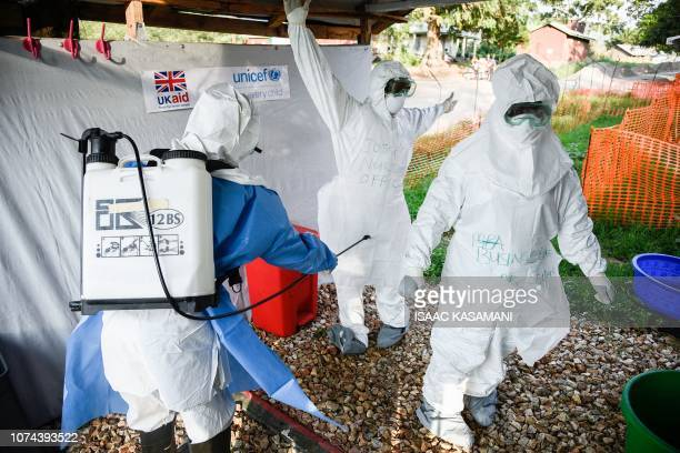 Medical staff of the Ebola Treatment Unit get ready to work in their Personal Protective Equipment during their weekly rehearsal at the Bwera General...