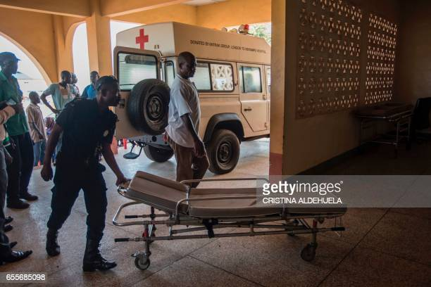 Medical staff prepare to move victims by ambulance on March 20 a day after 20 students lost their life in an accident at the Waterfalls in Kintampo...